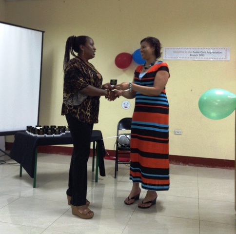 3.CDA's Executive Assistant Deverline Waller presents foster parent Viveen White with a certificate of appreciation at a recent function to celebrate parents from the North East Region (St. Ann, St. Mary and Portland) at the Ocho Rios Resource Centre, St. Ann.