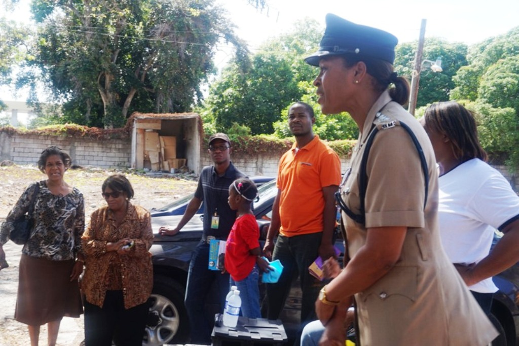 Deputy Superintendent of Police, Commanding Officer for the St. Thomas Division, Charmaine Shand speaks to Director Children and Family Programmes Audrey Budhi and other members of the CDA team prior to the start of their child abuse prevention and protection sensitisation walk, staged on Friday (March 27) in Yallahs, St. Thomas. The walk was aimed at sensitising persons about child abuse and protection.