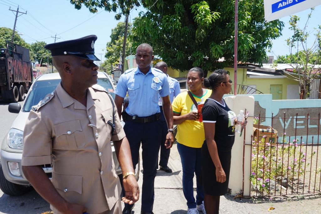 Deputy Superintendent of Police Beresford Williams joining the team of Child Development Agency's (CDA) officers during a child protection sensitisation walk, staged recently in Morant Bay, St. Thomas. The walkthrough is one of several being undertaken, geared at educating persons about child abuse prevention and the need to protect the nation's children.