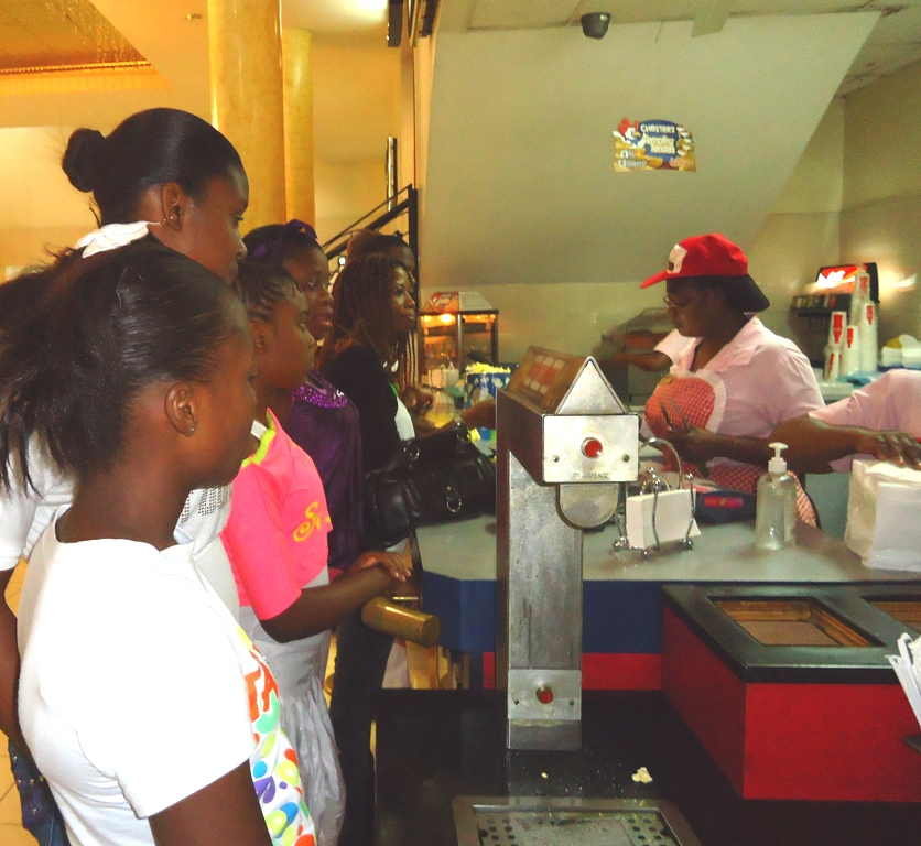 Children from State care enjoying the concession stand the Carib Cinema in Cross Roads.