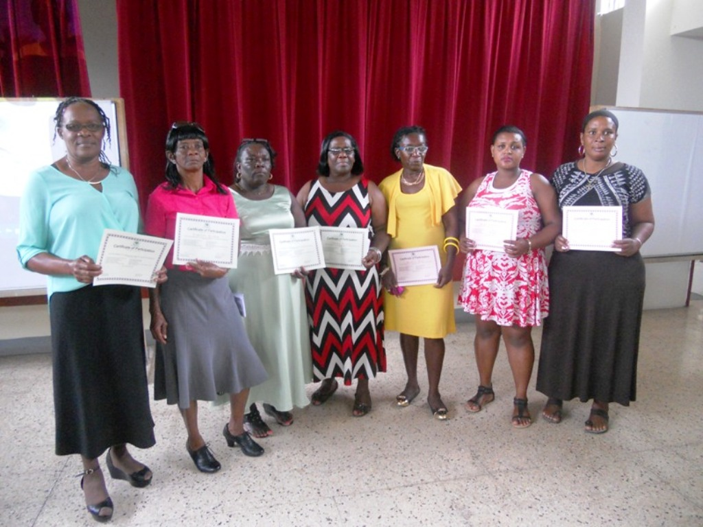 A group of parents from the parish of Hanover who participated in the  Child Development Agency's (CDA) Parenting Skills Training Workshop show off their certificates of participation after a recent graduation ceremony, held on Monday (April 30) at the Calvary Baptist Church Hall, in Montego Bay, St. James. A total of 87 parents participated in the twenty (20) hour workshop, geared at improving their parenting skills.