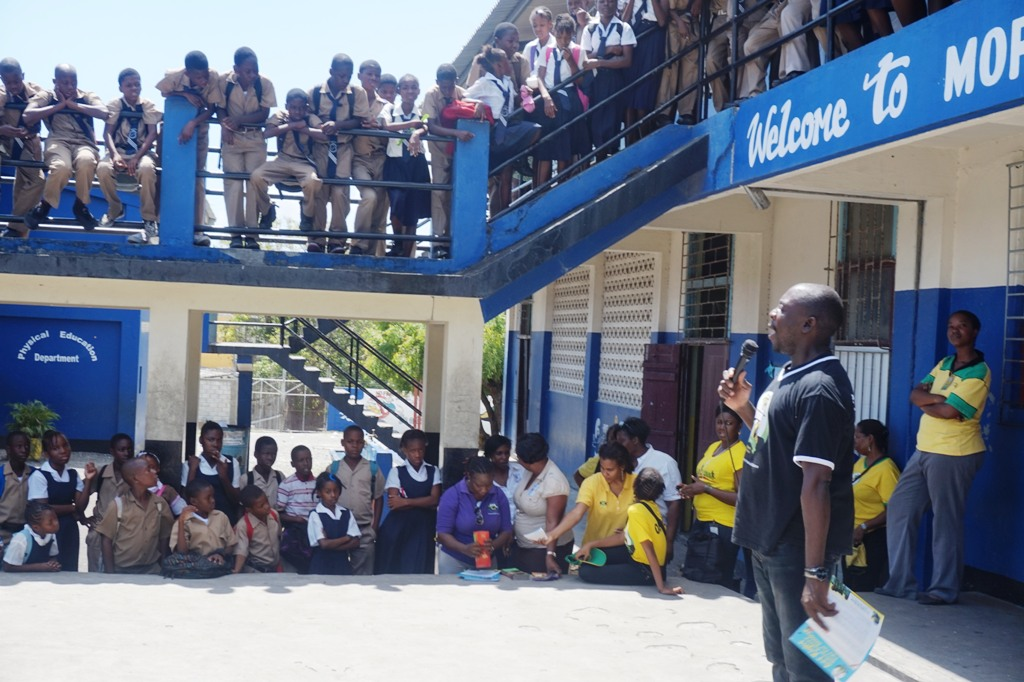 CDA's Regional Director for South East, Robert Williams (right) is supported by his team while making a presentation to students at the Morant Bay Primary recently. The initiative is part of an ongoing drive by the Agency to educate children about child abuse, their rights and participation, as well as school safety.