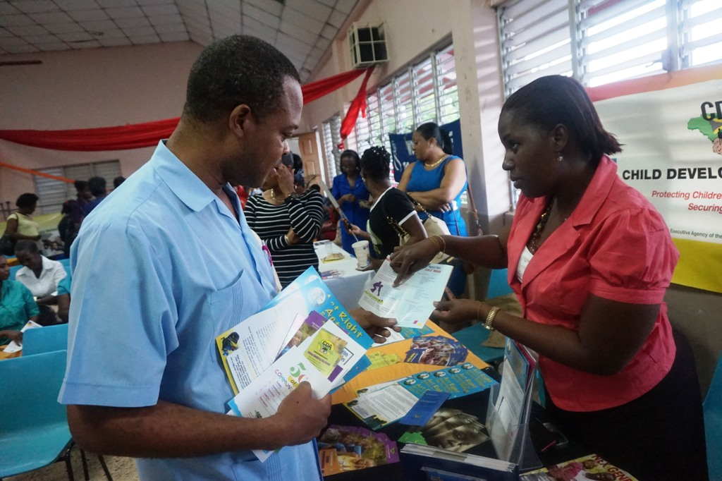 3.Childrens Officer from the Child Development Agency's (CDA's) Southern Region, Kimeahia Brown Reid (right) gives information to a parent at the Agency's recently held Circle of Care Family and Community Series at the St. Gabriel's Anglican Church in May Pen, Clarendon, on Thursday (April 16).