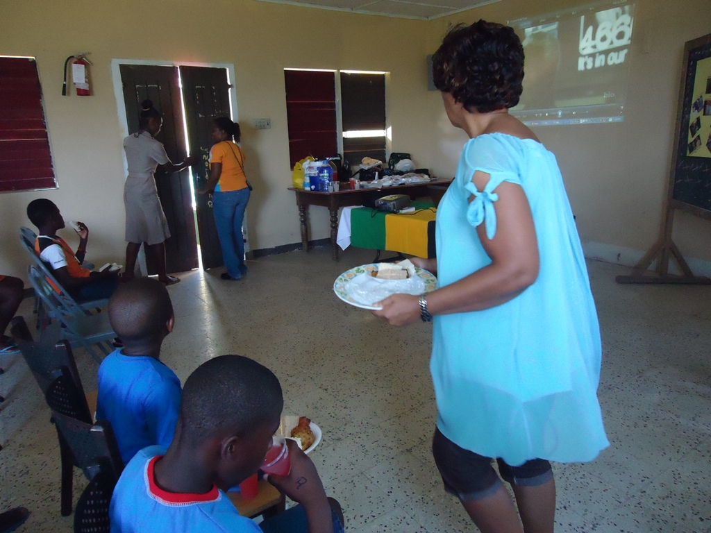 CDA's Social Worker and Team Leader for St. Mary Dotlyn Bailey serves the children from the Pringle Child Care Facility as part of the Agency's more than 67 minutes of service on Nelson Mandela International Day on July 18.
