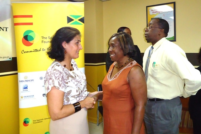 Spanish Ambassador to Jamaica Her Excellency Celsa Nuño (right) is greeted by  Manager for the Blossom Gardens Children's Home Paola Genas-Brown  and Manager for the  Manning Child Care Facility Delroy Brown. The Occasion was a ceremony held at the Child Development Agency (CDA) in which the Spanish-Jamaican Foundation made donation of personal hygiene products and medical supplies to eight CDA-operated children's homes.